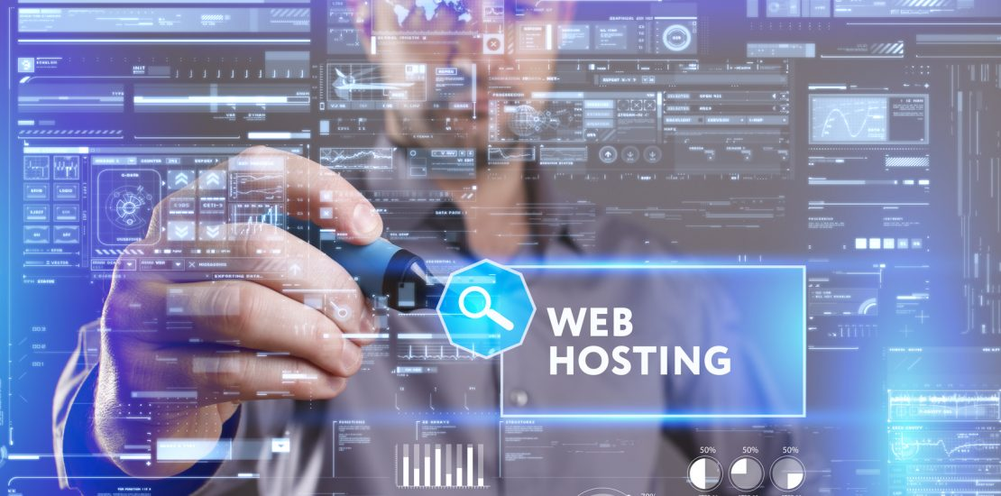Business, Technology, Internet and network concept. Young businessman working on a virtual screen of the future and sees the inscription: Web hosting